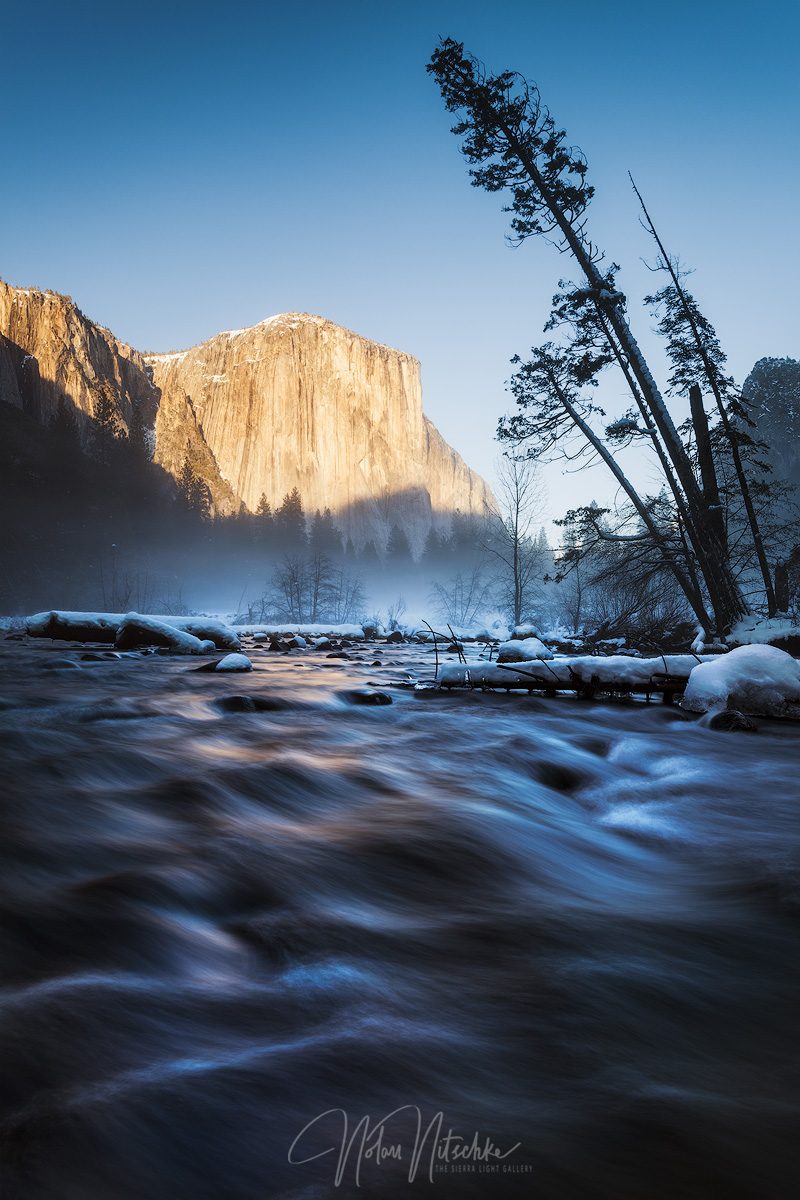 A misty valley underneath El Capitan and the Merced River.