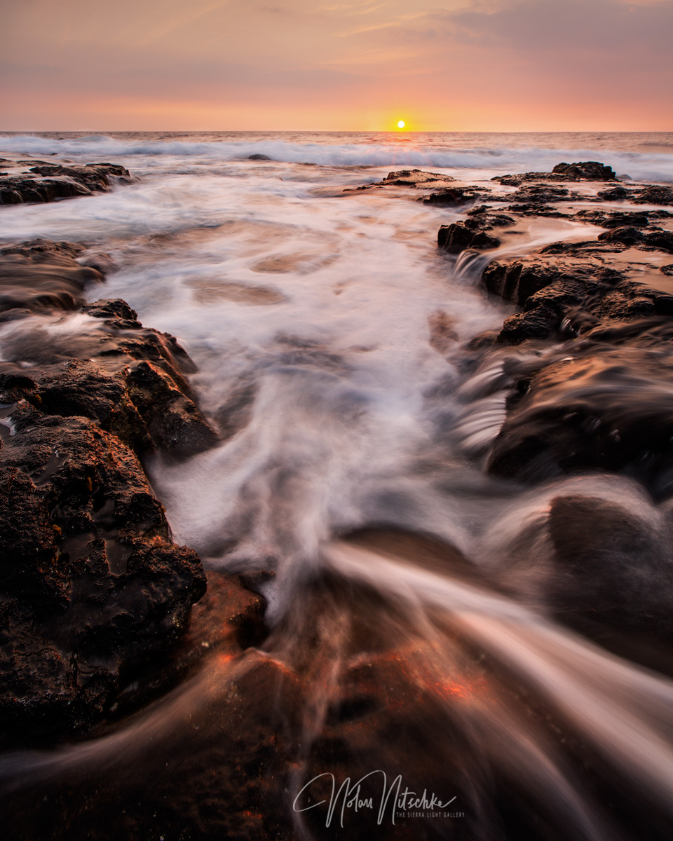 Water receding from the Big Island Coastline at sunset.