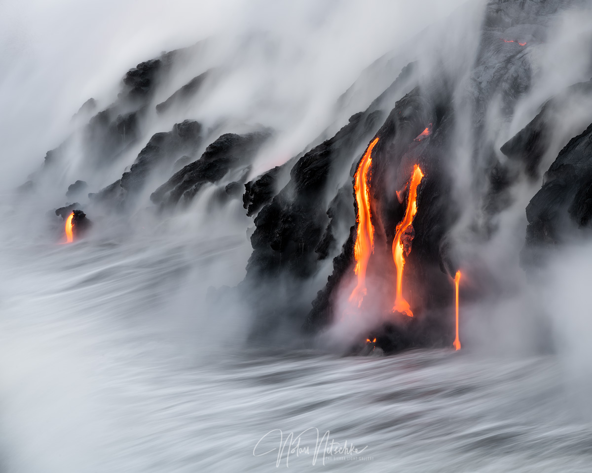 Lava pouring into the ocean during the 61G lava flow event.