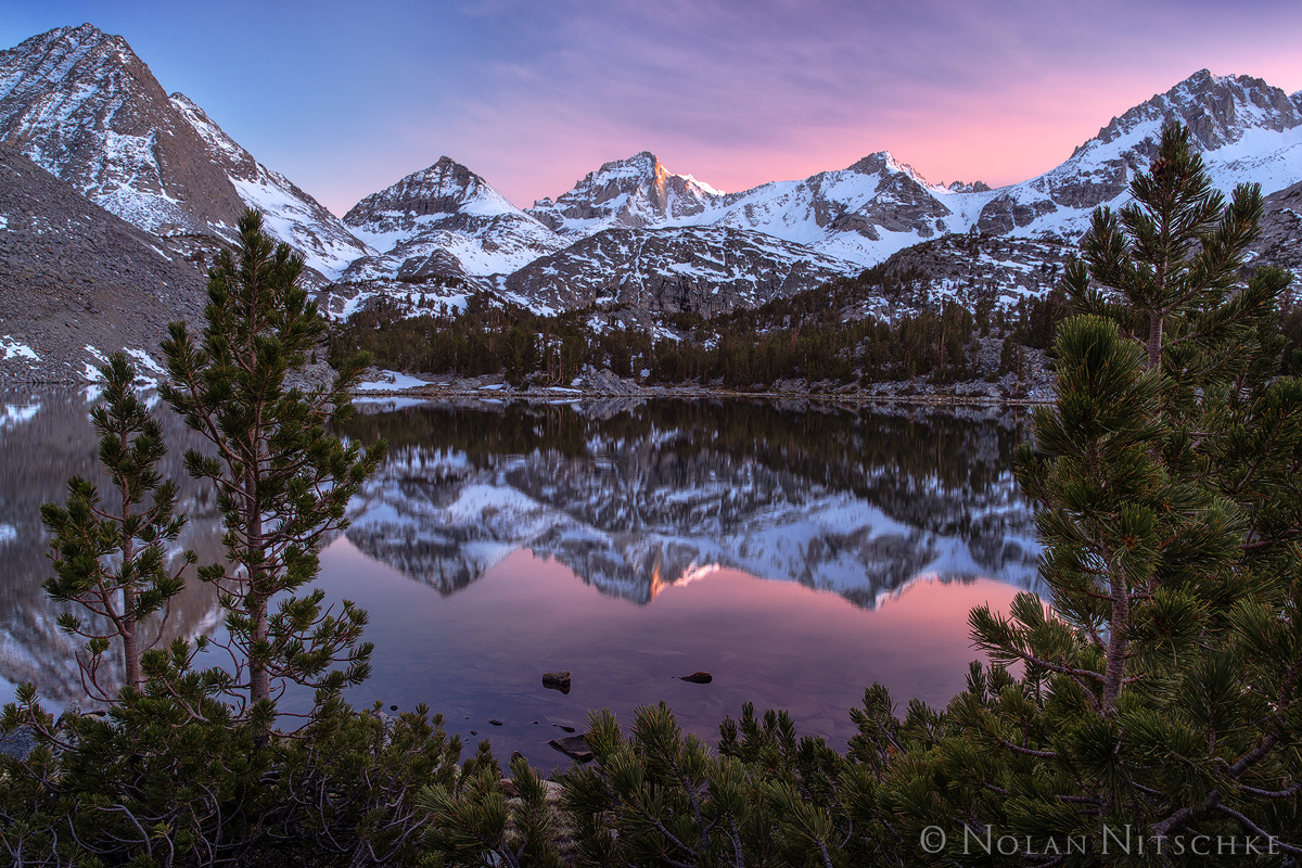 Bear Creek Spire reflecting in Little lakes Valley at Sunset.