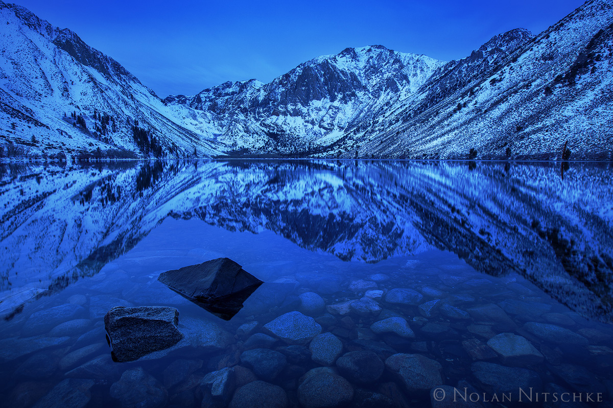 A glassy morning well before sunrise on Convict Lake.