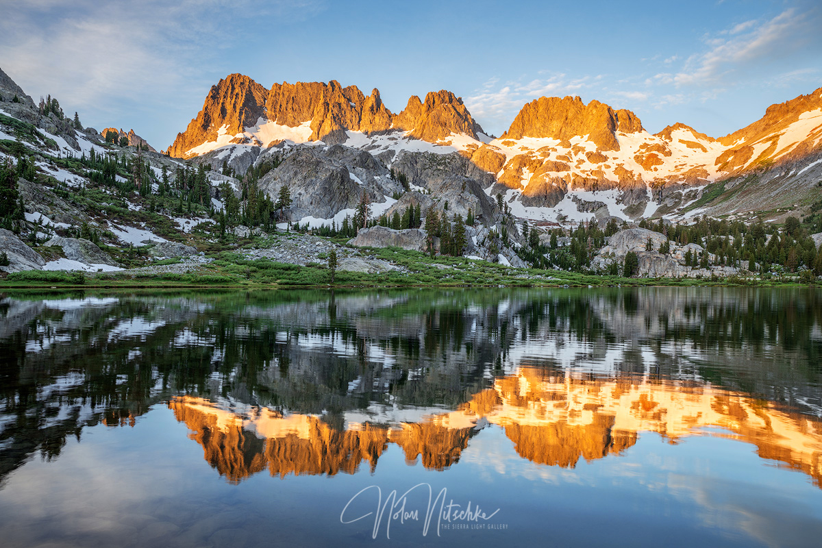 The Minarets at sunrise Reflecting on Lake Ediza in the Inyo National Forest and Eastern Sierra Nevada mountains.