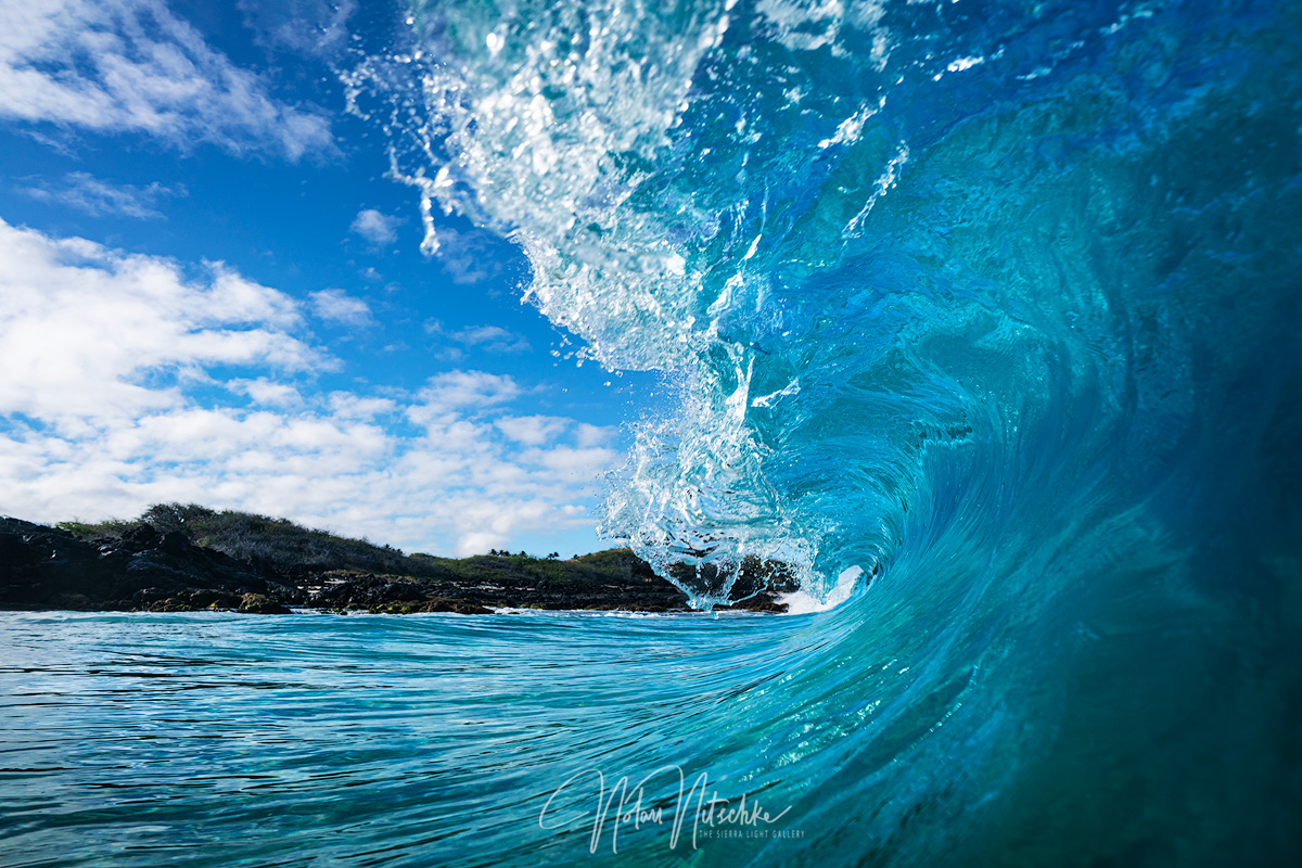 Beautiful blue waters crashing over the top of me at Kua Bay.