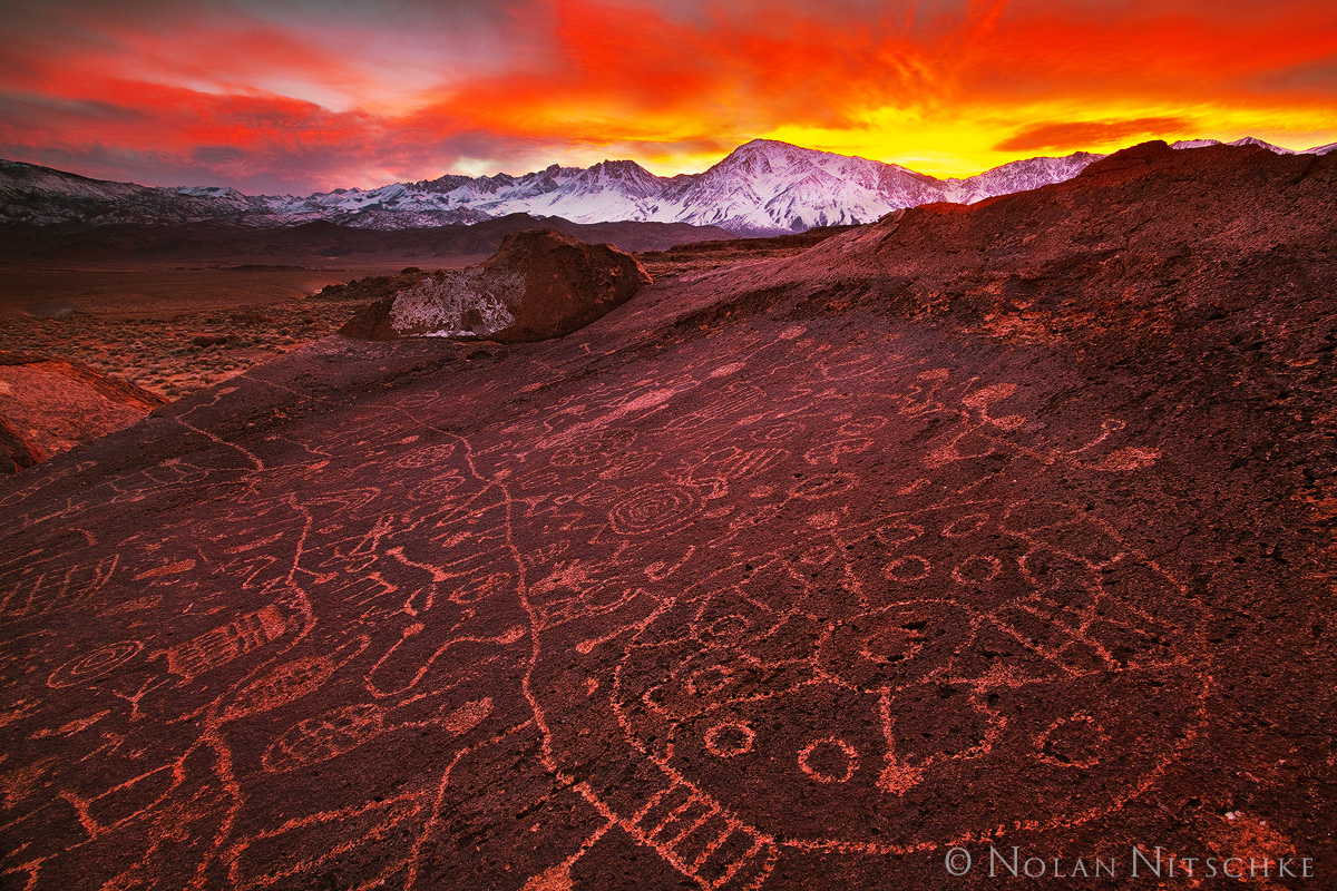 A truly impressive set of petroglyphs carved into the volcanic rock at sunset.