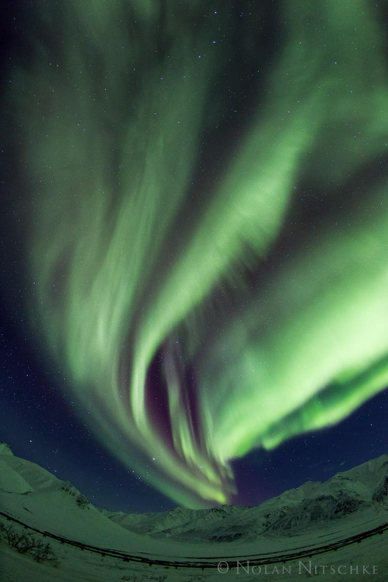 Limelight aurora dancing over the Brooks Range.
