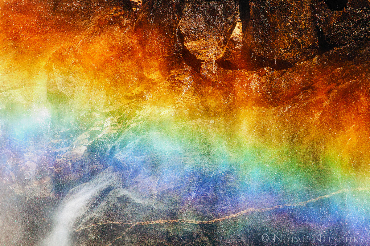Taken at Lower Yosemite Falls. In between the storms the sunshines through andcreate stunning rainbows in the mist...