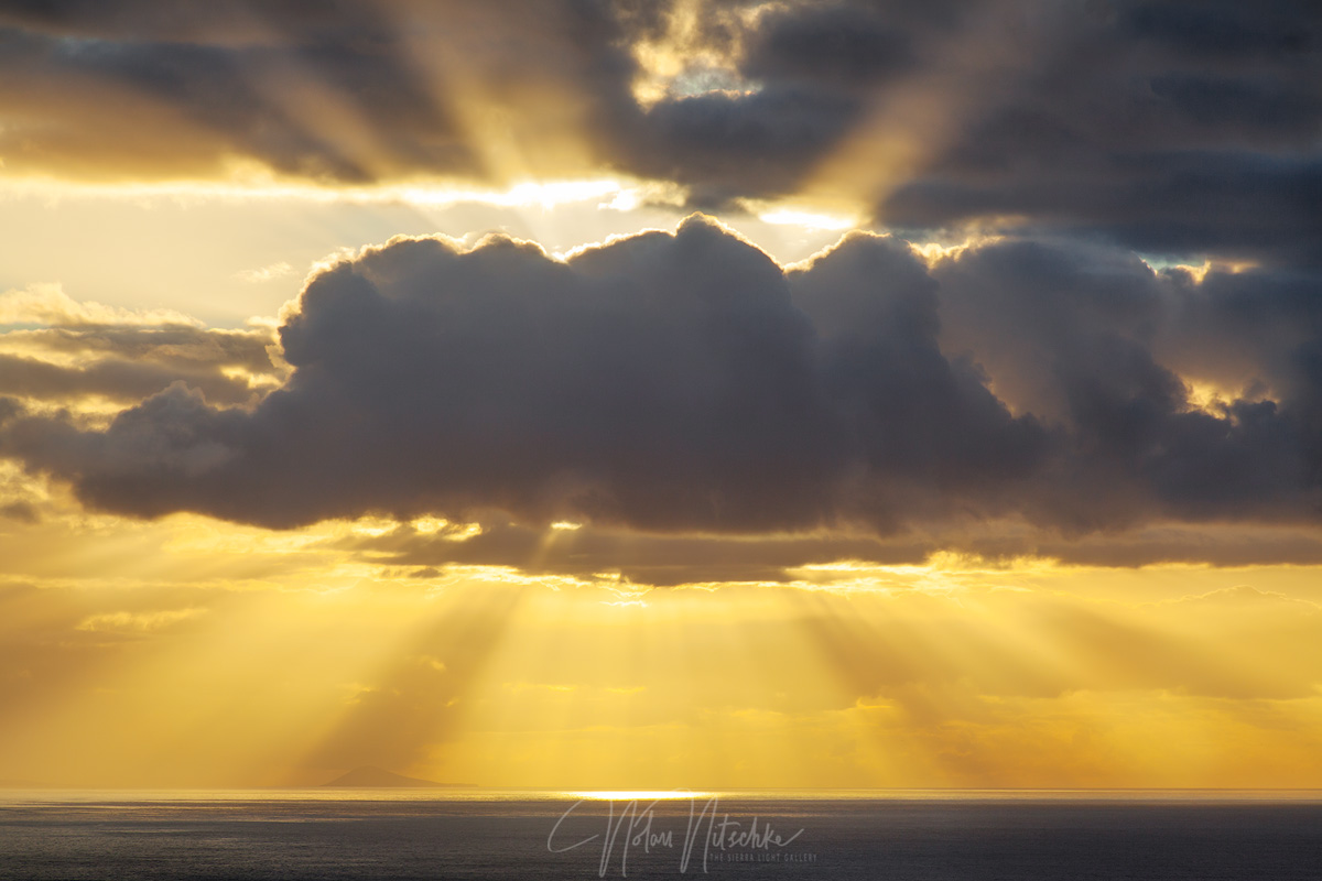 Light rays shining through the clouds off the Na Pali Coast.