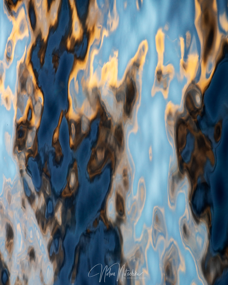 An abstract view of the colors of the setting sun and the beautiful blue waters of Lake Tahoe.