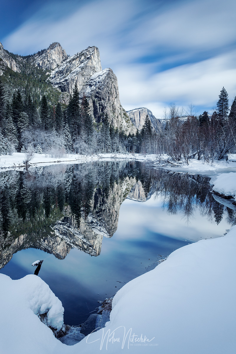 The Three Brothers reflecting in the Merced River on a stormy morning.